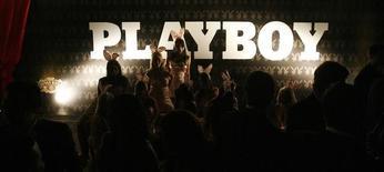 Вечеринка журнала Playboy в Каракасе. 11 октября 2007 года. Журнал Playboy вернётся к истокам и вновь будет публиковать фотографии полностью обнажённых женщин, спустя год после отказа от этой практики, которую тогда руководители издания назвали устаревшей. REUTERS/Jorge Silva