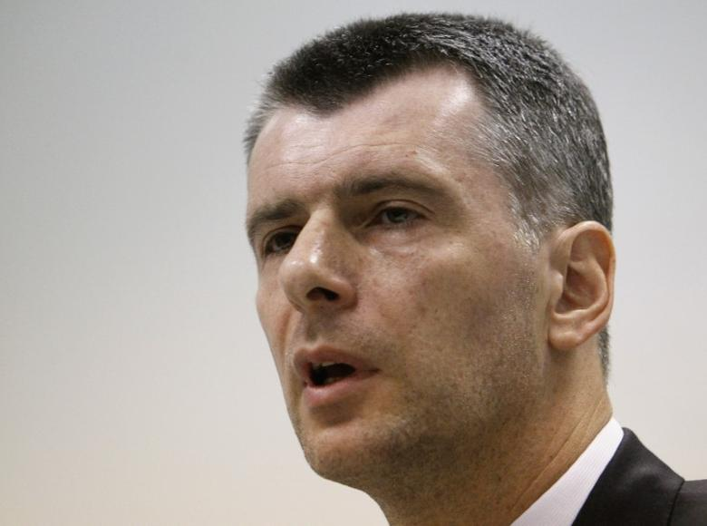 Russian billionaire Mikhail Prokhorov speaks during a news conference in Moscow June 13, 2013. REUTERS/Sergei Karpukhin
