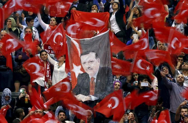 FILE PHOTO: A portrait of Turkey's President Tayyip Erdogan is seen as supporters wave flags before his speech at the Ethias Arena in Hasselt, Belgium, May 10, 2015.  REUTERS/Francois Lenoir/File Photo