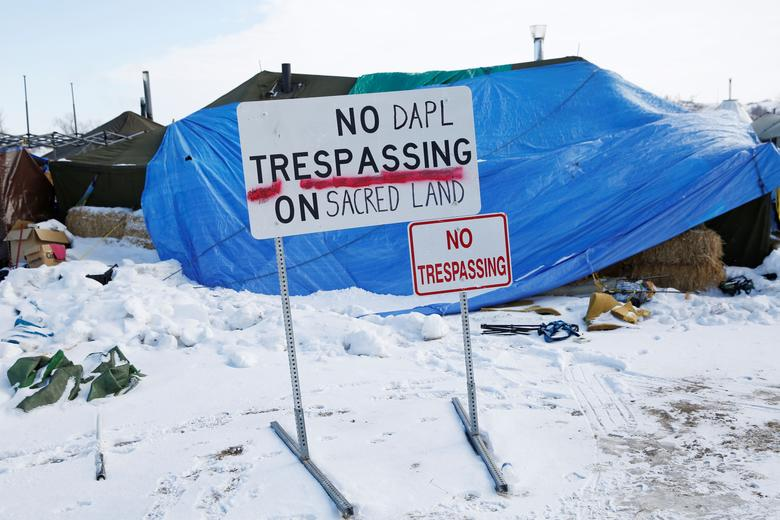 A modified ''No Trespassing'' sign is seen in the opposition camp against the Dakota Access oil pipeline (DAPL) near Cannon Ball, North Dakota, U.S., February 8, 2017. REUTERS/Terray Sylvester