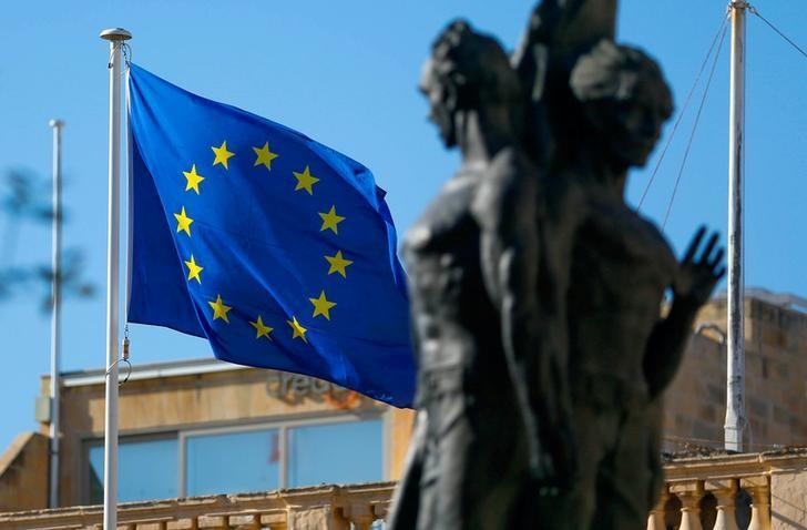 FILE PHOTO:A European flag flies outside Grandmaster's Palace on the eve of a European Union leaders summit in Valletta, Malta February 2, 2017. REUTERS/Yves Herman/File Photo