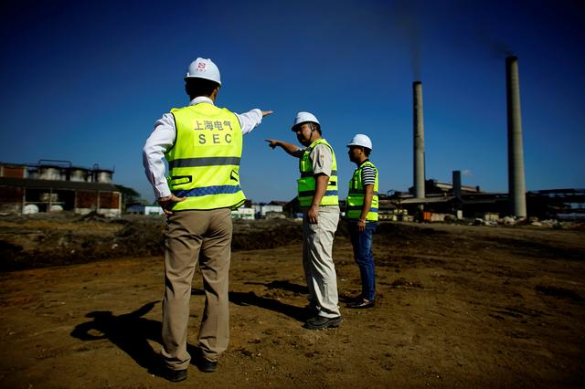 Chinese employees of Shanghai Electric company supervise the construction site of a biomass power station in Ciro Redondo, Cuba, February 9, 2017. REUTERS/Alexandre Meneghini