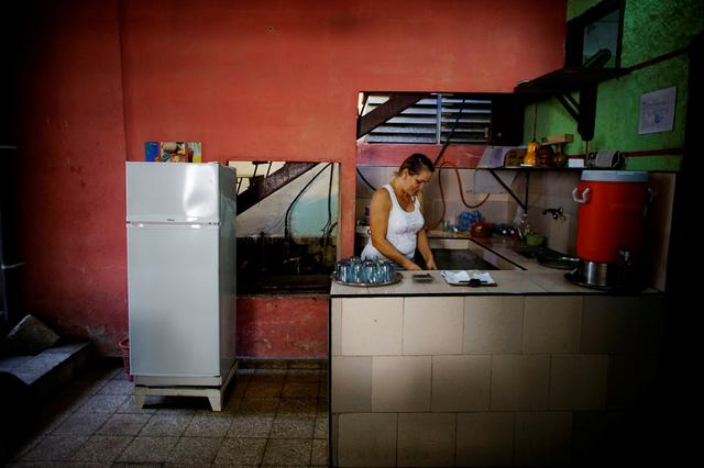 Aridania Rubens works beside a Chinese-made Haier refrigerator at her restaurant in Havana, Cuba, February 10, 2017. REUTERS/Alexandre Meneghini