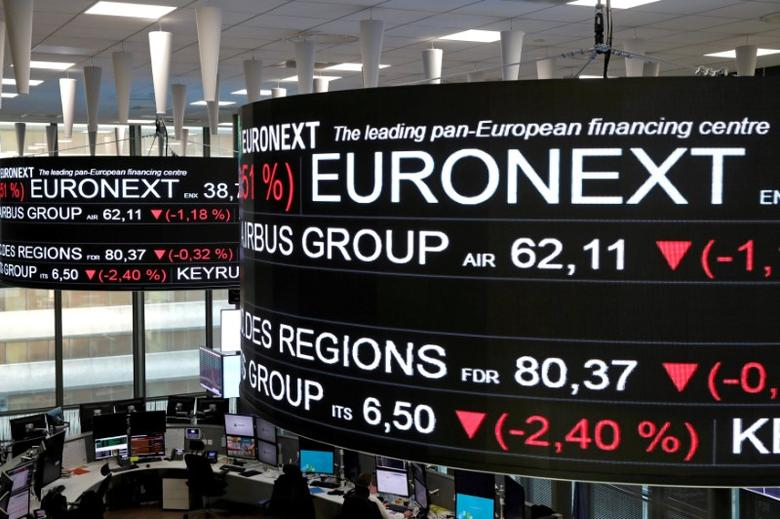 FILE PHOTO: Company stock price information are displayed on screens as they hang above the Paris stock exchange, operated by Euronext NV, in La Defense business district in Paris, France, December 14, 2016. REUTERS/Benoit Tessier/File Photo