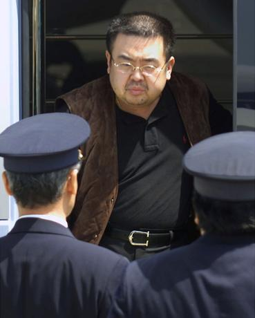 FILE PHOTO: North Korean heir-apparent Kim Jong Nam emerges from a bus as he is escorted by Japanese authorities upon his deportation from Japan at Tokyo's Narita international airport May 4, 2001.    REUTERS/Eriko Sugita/File Photo