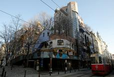 "The Hundertwasser House landmark, an apartment house designed by artist and architect Friedensreich Hundertwasser, with the ""Terrassencafe im Hundertwasserhaus"" is seen in Vienna, Austria, February 15, 2017. REUTERS/Heinz-Peter Bader"
