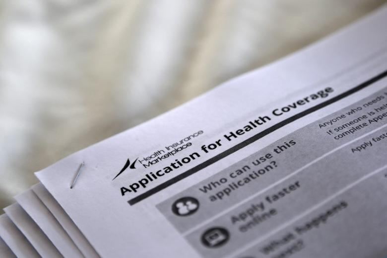 FILE PHOTO - The federal government forms for applying for health coverage are seen at a rally held by supporters of the Affordable Care Act, widely referred to as ''Obamacare'', outside the Jackson-Hinds Comprehensive Health Center in Jackson, Mississippi, U.S. on October 4, 2013.  REUTERS/Jonathan Bachman/File Photo
