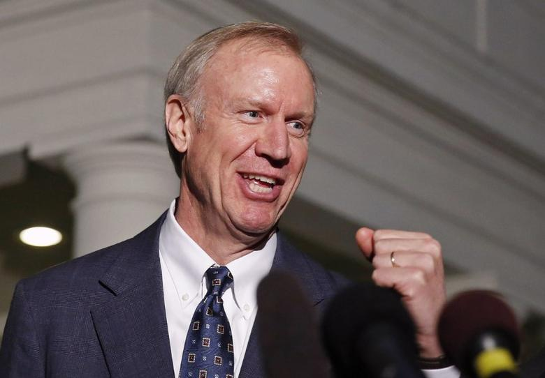 FILE PHOTO - Illinois Gov-elect Bruce Rauner talks to the media after a meeting with U.S. President Barack Obama at the White House in Washington December 5, 2014.       REUTERS/Larry Downing/File Photo