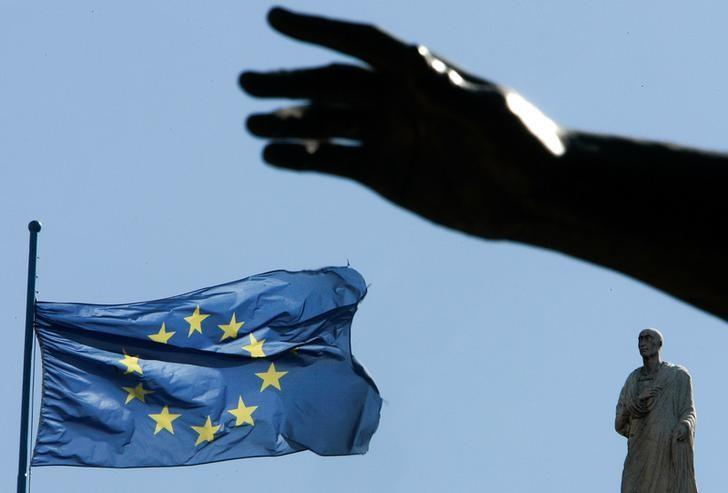 A European Union flag flutters near the hand of a statue on Campidoglio square in central Rome, Italy, March 23 2007. REUTERS/Tony Gentile/Files