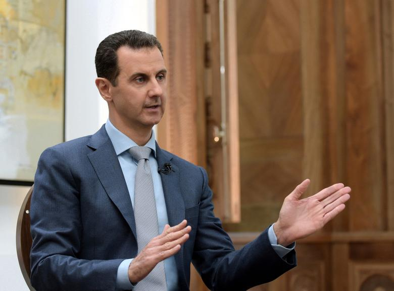 Syria's President Bashar al-Assad speaks during an interview with Yahoo News in this handout picture provided by SANA on February 10, 2017, Syria.  SANA/Handout via REUTERS