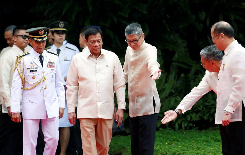 FILE PHOTO -  Incoming President Rodrigo Duterte walks towards outgoing President Benigno Aquino before Aquino leaves the Malacanang Palace in Manila, Philippines June 30, 2016. To match Insight PHILIPPINES-DRUGS/CHILDREN  REUTERS/Erik De Castro/File Photo
