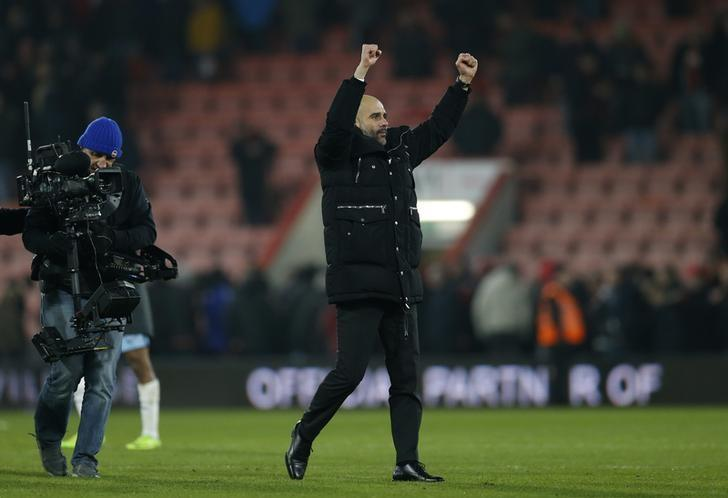 Britain Football Soccer - AFC Bournemouth v Manchester City - Premier League - Vitality Stadium - 13/2/17 Manchester City manager Pep Guardiola celebrates after the game  Action Images via Reuters / Matthew Childs Livepic