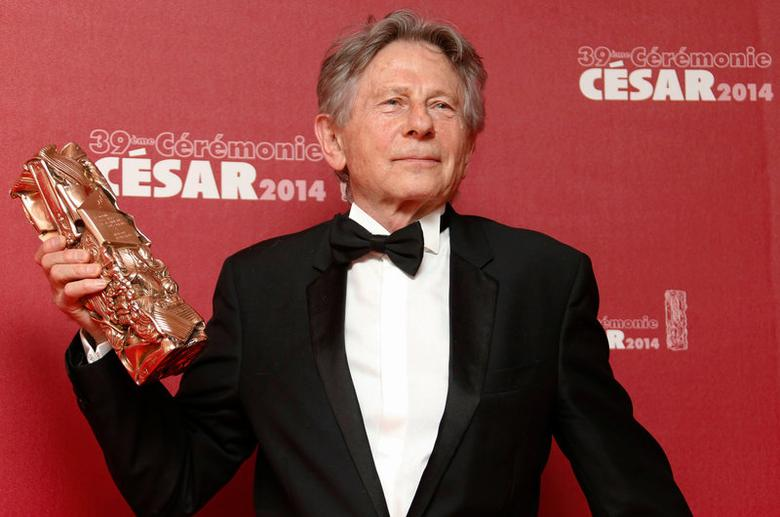 FILE PHOTO -- Director Roman Polanski, who has turned down an invitation to head the jury at France's Cesar film awards following an outcry from women's groups, poses with his Best Director award for ''La Venus A La Fourrure'' (Venus in Fur) during a photocall at the 39th Cesar Awards ceremony in Paris, France, February 28, 2014. REUTERS/Regis Duvignau/File Photo