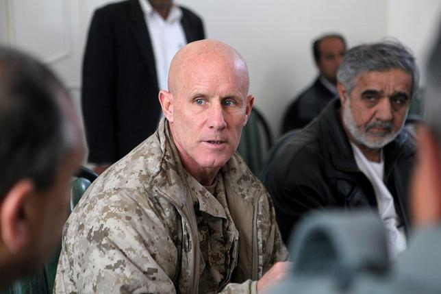 Vice Adm. Robert S. Harward, commanding officer of Combined Joint Interagency Task Force 435, speaks to an Afghan official during his visit to Zaranj, Afghanistan, in this January 6, 2011 handout photo.    Sgt. Shawn Coolman/U.S. Marines/Handout via REUTERS