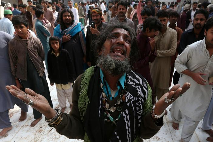 A man mourns the death of a relative who was killed in a suicide blast at the tomb of Sufi saint Syed Usman Marwandi, also known as the Lal Shahbaz Qalandar shrine, on Thursday evening in Sehwan Sharif, Pakistan's southern Sindh province, February 17, 2017. REUTERS/Akhtar Soomro