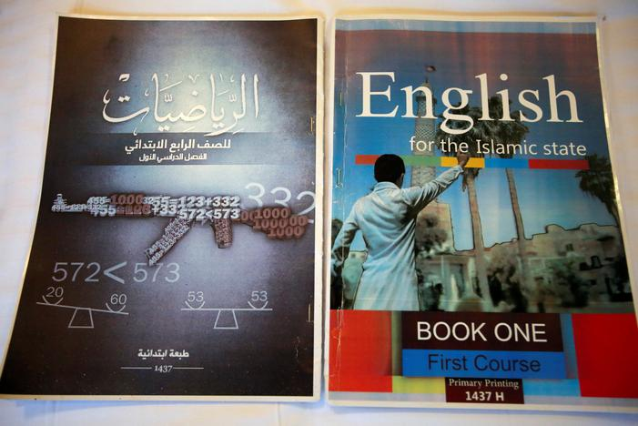 Math and English textbooks found in an Islamic State facility for child fighters, which include military imagery, are pictured in Mosul, Iraq, February 16, 2017. REUTERS/Khalid al Mousily
