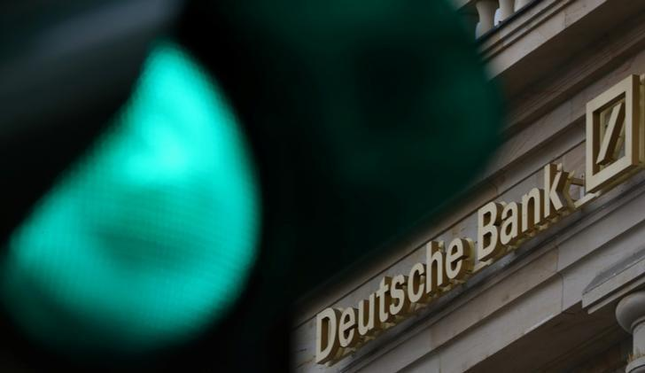 A green traffic light is seen next to the logo of Germany's largest business bank, Deutsche Bank in Frankfurt, Germany, October 27, 2016.   REUTERS/Kai Pfaffenbach