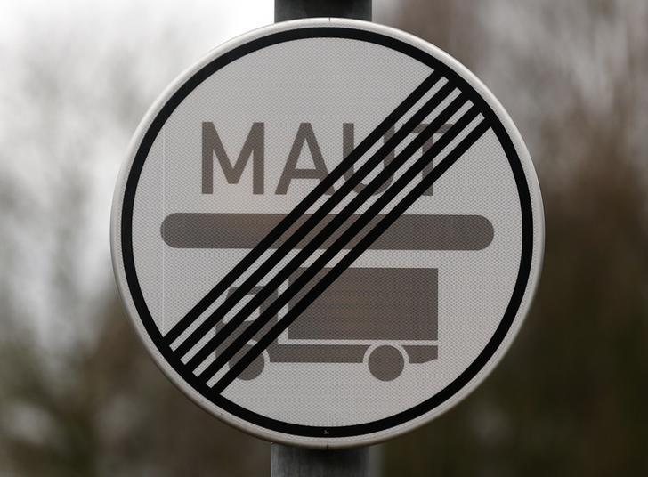 A traffic sign showing no road toll for trucks is pictured in Ingolstadt, the home of German carmaker Audi March 3, 2016.           REUTERS/Michael Dalder