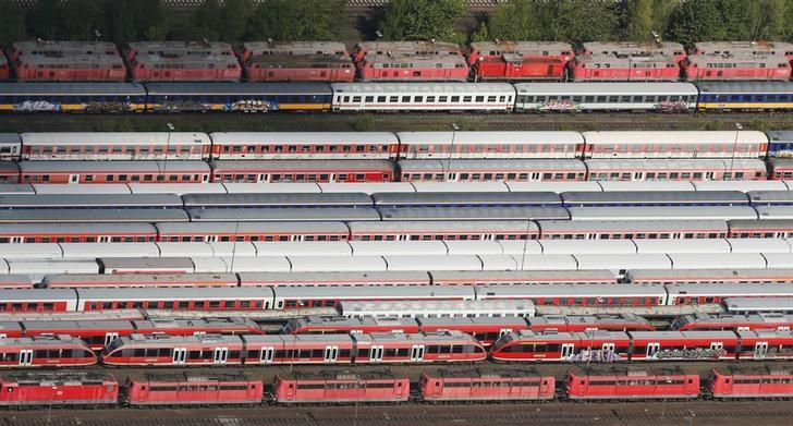 Train carriages, locomotives and freight trains of German railways Deutsche Bahn are parked at a storage facility in the North Rhine-Westphalian town of Hamm near Dortmund, Germany May 6, 2015. A record-setting seven-day strike by the GDL union of train drivers began on Monday, the eighth in a series of walkouts over pay and working conditions, threatening commuter chaos and disruption to vital supply chains.    REUTERS/Wolfgang Rattay