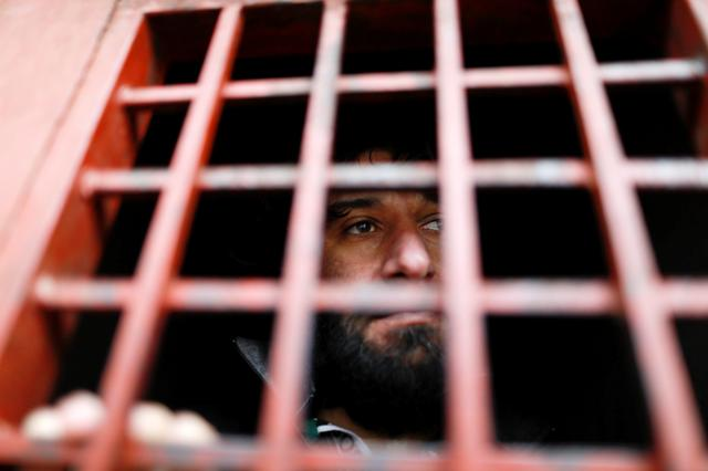 Ghaffar Abdel Rahman, 33, an Islamic State member, looks out from a prison cell in Sulaimaniya, Iraq February 15, 2017.  REUTERS/Zohra Bensemra