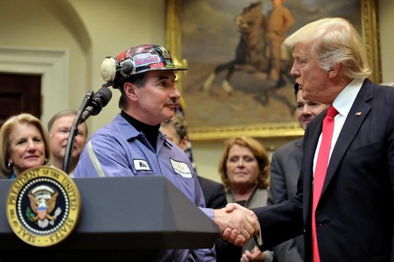 Michael Nelson, a coal miner worker shakes hands with U.S. President Donald Trump as he prepares to sign Resolution 38, which nullfies the ''stream protection rule'', at the White House in Washington, U.S., February 16, 2017. REUTERS/Carlos Barria -