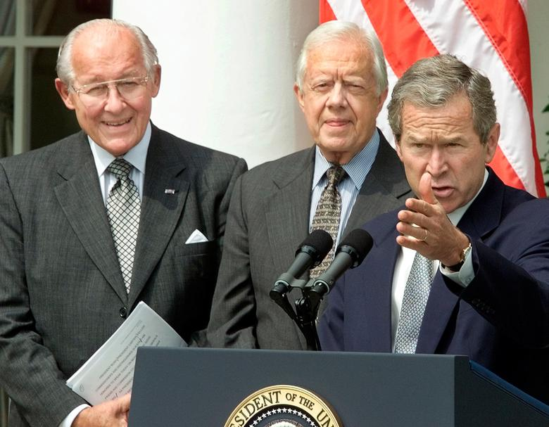 FILE PHOTO --  U.S. President George W. Bush speaks while receiving the Report of the National Commission on Federal Election Reform from former President Jimmy Carter (C) and former House Minority Leader Bob Michel (L) while in the Rose Garden of the White House in Washington, D.C., U.S., July 31, 2001.  REUTERS/Staff/File Photo