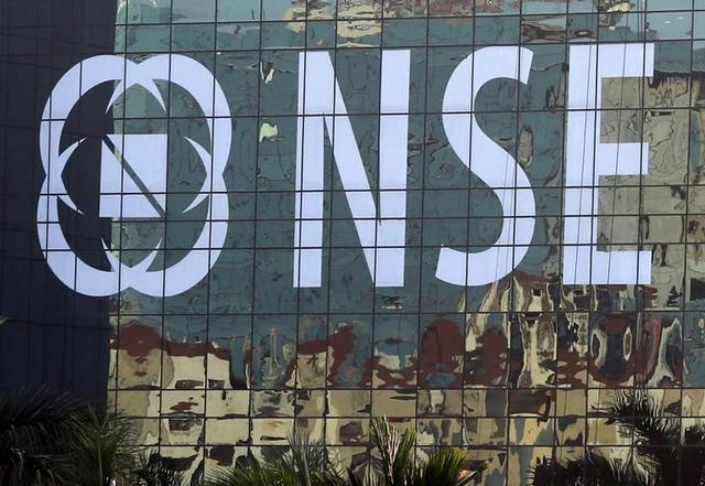 Buildings are reflected on the glass windows of the NSE (National Stock Exchange) building in Mumbai, India, December 27, 2016. REUTERS/Shailesh Andrade/Files