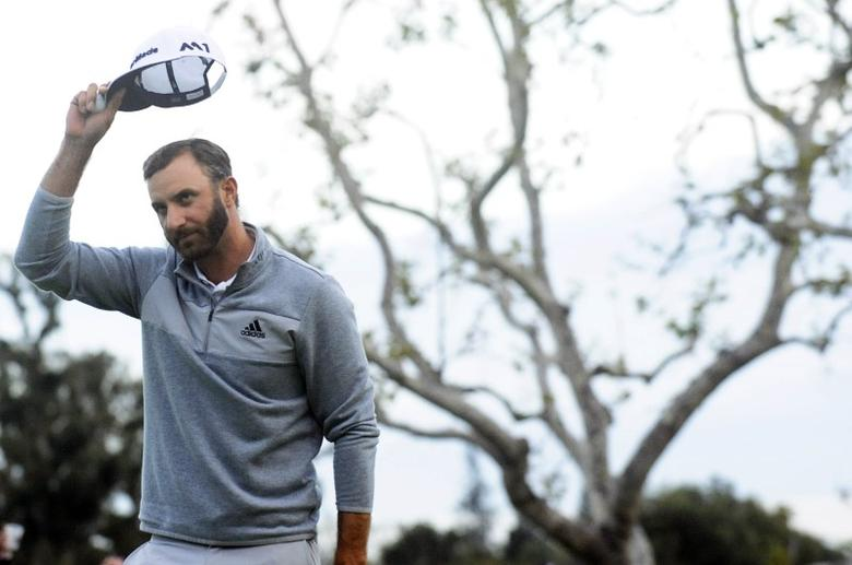 February 19, 2017; Pacific Palisades, CA, USA;  Dustin Johnson reacts after making his putt on the eighteenth hole green to win thethe Genesis Open golf tournament at Riviera Country Club. Gary A. Vasquez-USA TODAY Sports