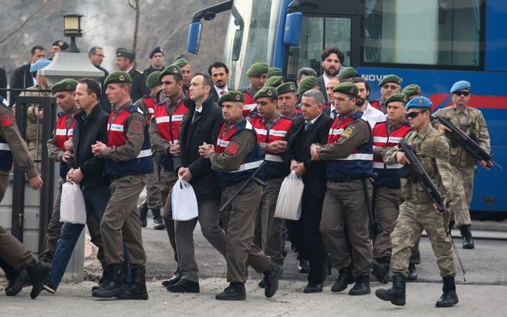 Turkish soldiers accused of attempting to assassinate President Tayyip Erdogan on the night of the failed last year's July 15 coup, are escorted by gendarmes as they arrive for the first hearing of the trial in Mugla, Turkey, February 20, 2017. REUTERS/Kenan Gurbuz
