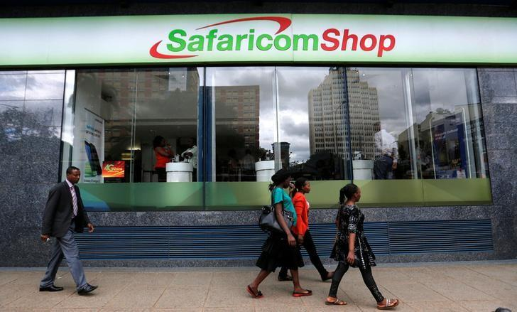 Pedestrians walk past a mobile phone care centre operated by Kenyan's telecom operator Safaricom in the central business district of Kenya's capital Nairobi, May 11, 2016. REUTERS/Thomas Mukoya/File Photo