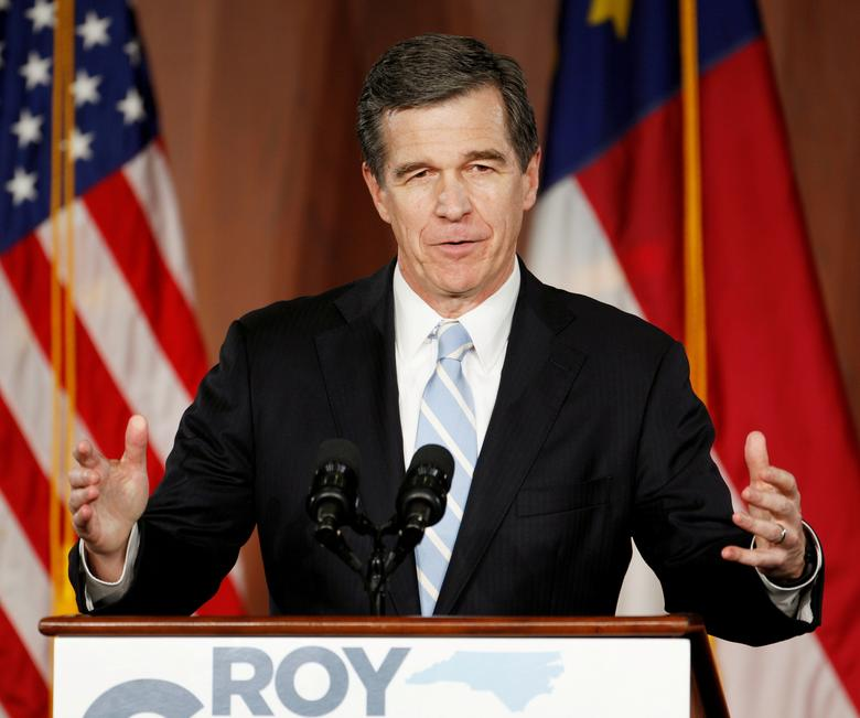 FILE PHOTO: North Carolina Governor-elect Roy Cooper speaks to supporters at a victory rally the day after his Republican opponent and incumbent Pat McCrory conceded in Raleigh, North Carolina, U.S., December 6, 2016. REUTERS/Jonathan Drake/File Photo