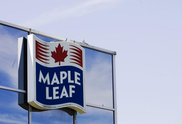 FILE PHOTO - A sign for the Maple Leaf food processing plant is seen in Toronto August 21, 2008. REUTERS/Mark Blinch (CANADA)
