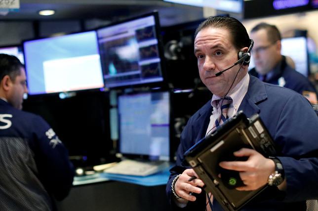 Traders work on the floor of the New York Stock Exchange (NYSE) in New York, U.S., February 17, 2017. REUTERS/Brendan McDermid