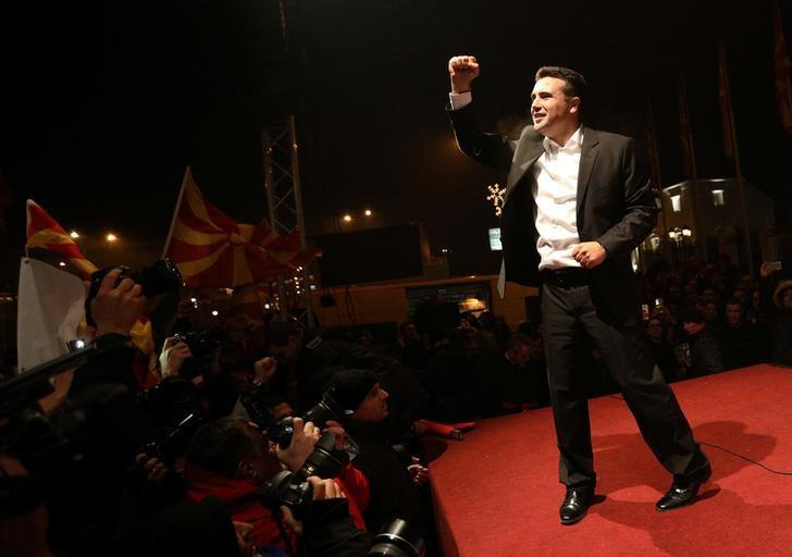 The leader of the opposition Social Democratic Union of Macedonia (SDSM) Zoran Zaev celebrates with supporters during parliamentary elections in Skopje, Macedonia, December 11, 2016. REUTERS/Stoyan Nenov/File