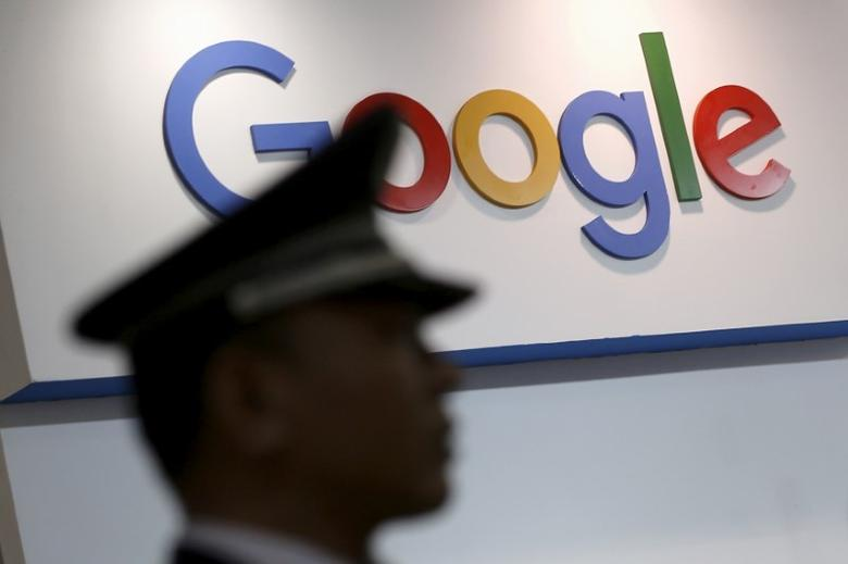 A security guard keeps watch as he walks past a logo of Google in Shanghai, China, April 21, 2016. REUTERS/Aly Song/Files