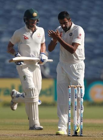 Cricket - India v Australia - First Test cricket match - Maharashtra Cricket Association Stadium, Pune, India - 24/02/17. India's Ravichandran Ashwin (R) celebrates the wicket of Australia's Mitchell Starc (L). REUTERS/Danish Siddiqui
