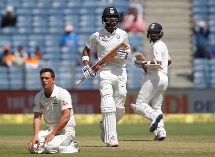 Cricket - India v Australia - First Test cricket match - Maharashtra Cricket Association Stadium, Pune, India - 24/02/17. India's Lokesh Rahul and Ajinkya Rahane run between the wickets. REUTERS/Danish Siddiqui