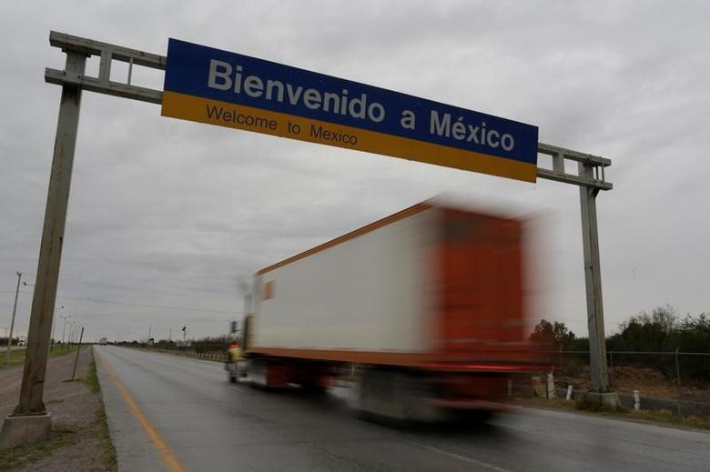 A truck passes near border customs at the World Trade Bridge in Nuevo Laredo, Mexico, January 28, 2017. REUTERS/Daniel Becerril