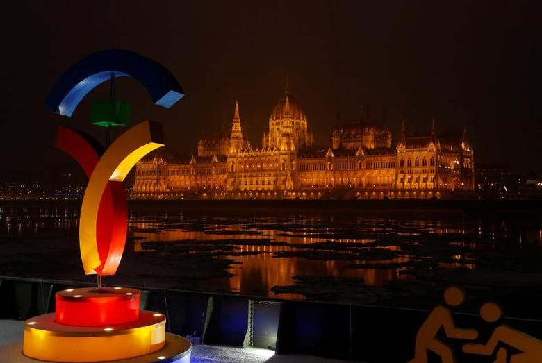 The Hungarian Parliament is seen behind Hungary's Olympic logo at a promotional spot as the Hungarian capital bids for the 2024 Olympic Games, in central Budapest, Hungary January 31, 2017.  REUTERS/Laszlo Balogh