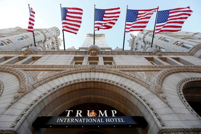 FILE PHOTO --  Flags fly above the entrance to the new Trump International Hotel on its opening day in Washington, DC, U.S. September 12, 2016. REUTERS/Kevin Lamarque/File Photo
