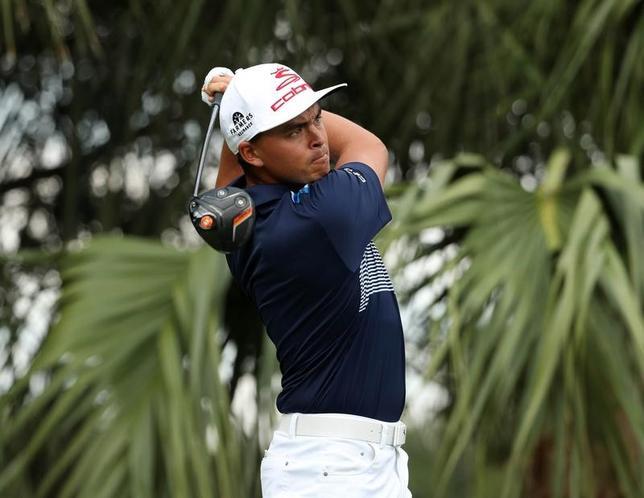 2月25日、米男子ゴルフのホンダ・クラシック第3ラウンド、リッキー・ファウラーが65で回り、通算13アンダーで単独首位に立った(2017年 ロイター/Jason Getz-USA TODAY Sports)