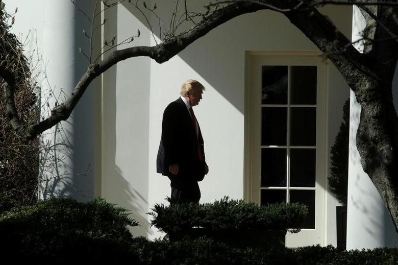 U.S. President Donald Trump walks to the Oval Office of the White House in Washington, U.S., February 24, 2017. REUTERS/Yuri Gripas