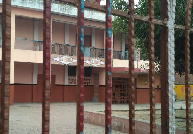 Locked gates of Krishna Talkies. Photo by Zeyad Khan