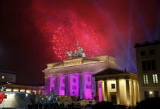 FILE PHOTO:Fireworks explode next to the Quadriga sculpture atop the Brandenburg gate during New Year celebrations in Berlin, Germany, January 1, 2017.   REUTERS/Fabrizio Bensch/File Photo