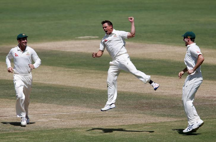 Cricket - India v Australia - First Test cricket match - Maharashtra Cricket Association Stadium, Pune, India - 25/02/17. Australia's Steve O'Keefe (C) celebrates with team mates the wicket of India's captain Virat Kohli. REUTERS/Danish Siddiqui