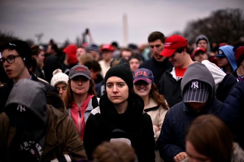 The crowd on the National Mall reacts during the inauguration of U.S. President Donald Trump in Washington, U.S., January 20, 2017. REUTERS/James Lawler Duggan