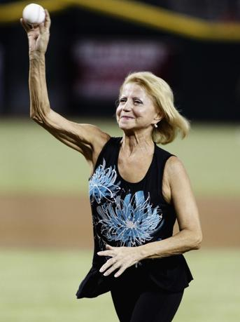 Former gymnast and Olympic gold medalist Olga Korbut throws out the first pitch before the start of a MLB interleague game between the Toronto Blue Jays and Arizona Diamondbacks in Phoenix, Arizona, September 3, 2013. REUTERS/Ralph D. Freso