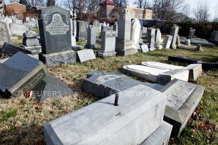Headstones lay on the ground after vandals pushed them off their bases in the Mount Carmel Cemetery, a Jewish cemetery, in Philadelphia, Pennsylvania, U.S. February 27, 2017. REUTERS/Tom Mihalek