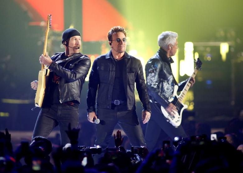 Bono (C), guitarist The Edge (L) and bass guitarist Adam Clayton of U2 perform during the iHeartRadio Music Festival at The T-Mobile Arena in Las Vegas, Nevada, U.S. on September 23, 2016. REUTERS/Steve Marcus/File Photo