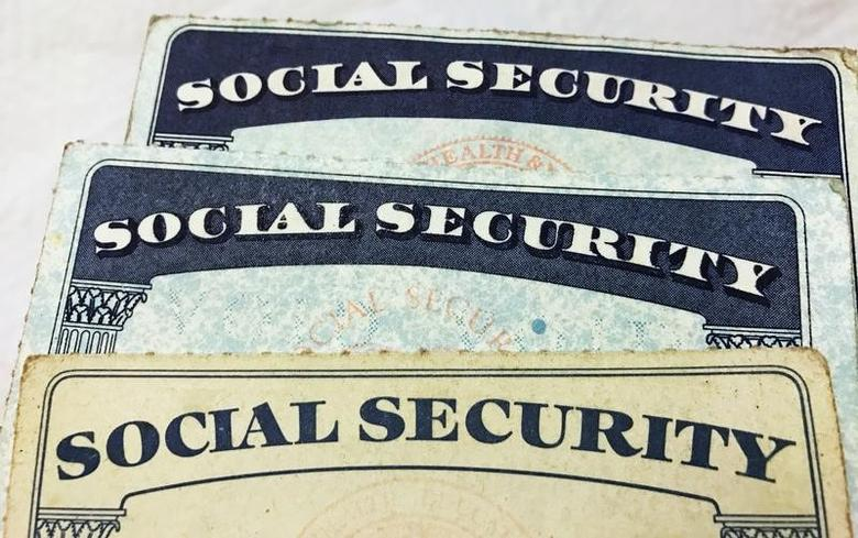 U.S. Social Security card designs over the past several decades are shown in this photo illustration taken in Toronto, Canada on January 7, 2017.  REUTERS/Hyungwon Kang
